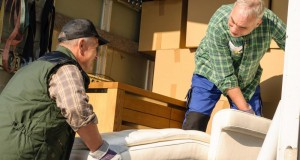 two-men-moving-boxes-and-furniture